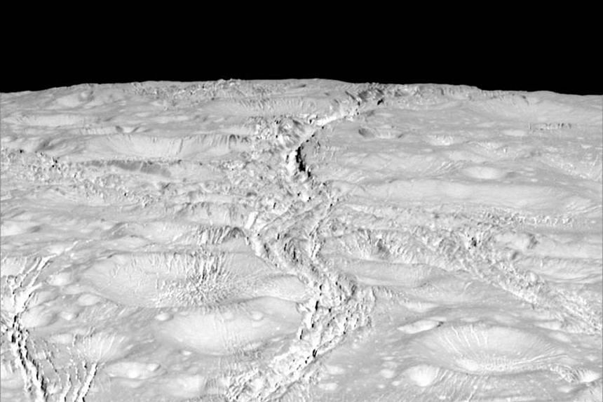 The north pole of Saturn's icy moon Enceladus is seen in an image from NASA's Cassini spacecraft taken on Oct 14.