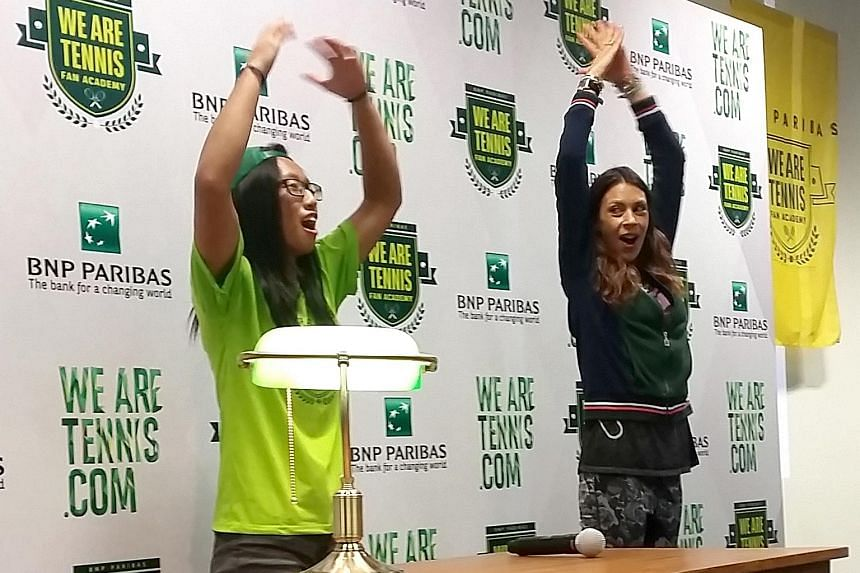 Undergraduate Debbie Tan (left) and 2013 Wimbledon champion Marion Bartoli share the stage during the BNP Paribas We Are Tennis Fan Academy yesterday at the OCBC Arena.