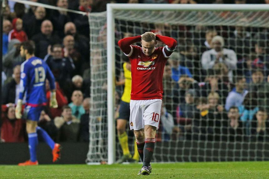Wayne Rooney failed to convert a penalty as Manchester United lost 3-1 on spot-kicks to second-tier Middlesbrough in the League Cup.