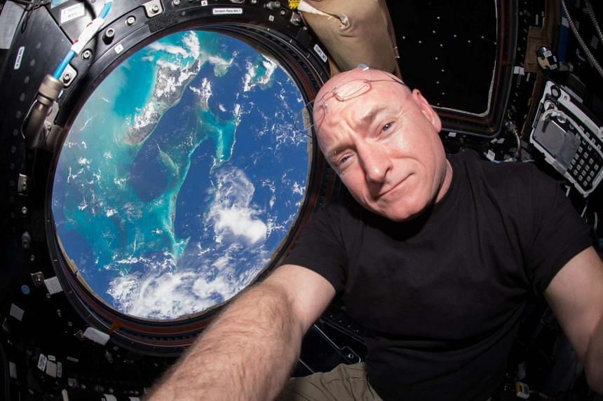 US astronaut Scott Kelly inside the Cupola, a European Space Agency (ESA)-built observatory module of the International Space Station (ISS).