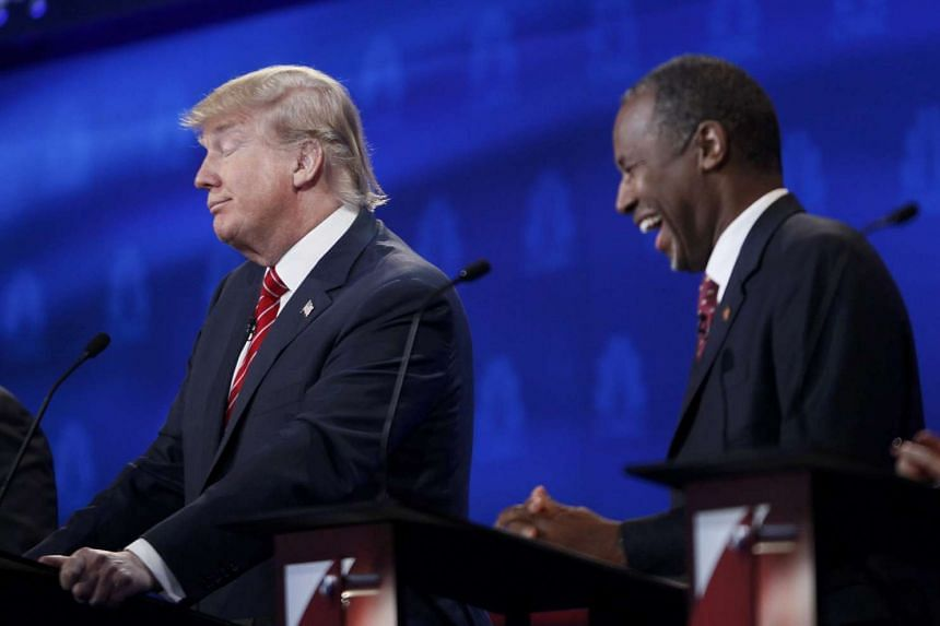 Mr Ben Carson (right) and businessman Donald Trump at the 2016 US Republican presidential candidates debate held by CNBC in Boulder, Colorado, on Oct 28, 2015.