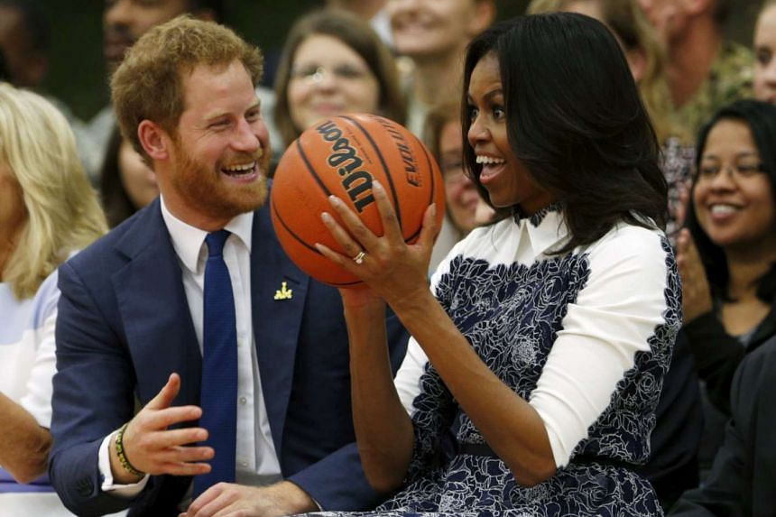 Britain's Prince Harry laughs as US first lady Michelle Obama catches a basketball during a game played by wounded warriors at Fort Belvoir, Virginia, on Oct 28, 2015.