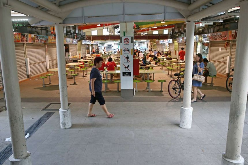 People at a hawker centre in Bedok.