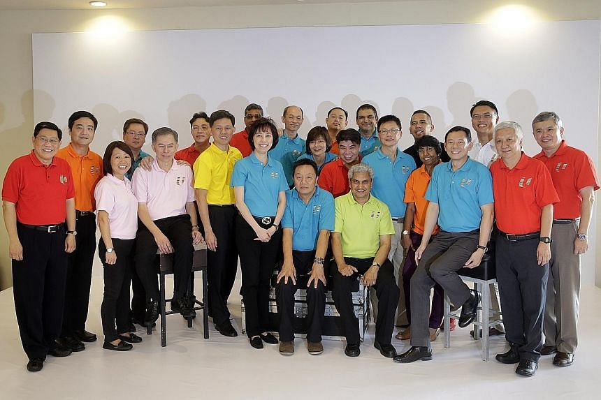 Former MP Yeo Guat Kwang (far left) and labour MP Ang Hin Kee (far right) with the new central committee members (from left to right): Mr Heng Chee How, Ms Eileen Yeo, Mr Richard Tan, Mr Yeo Chun Fing, Mr Benjamin Tang, secretary- general Chan Chun S