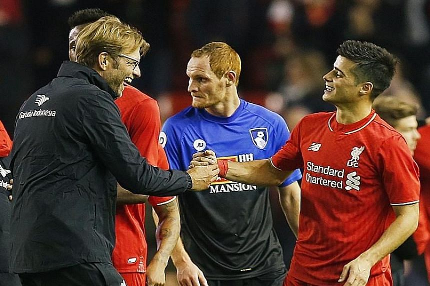 Liverpool manager Juergen Klopp celebrating with Joao Teixeira. The midfielder helped set up the Reds' winning goal against Bournemouth.