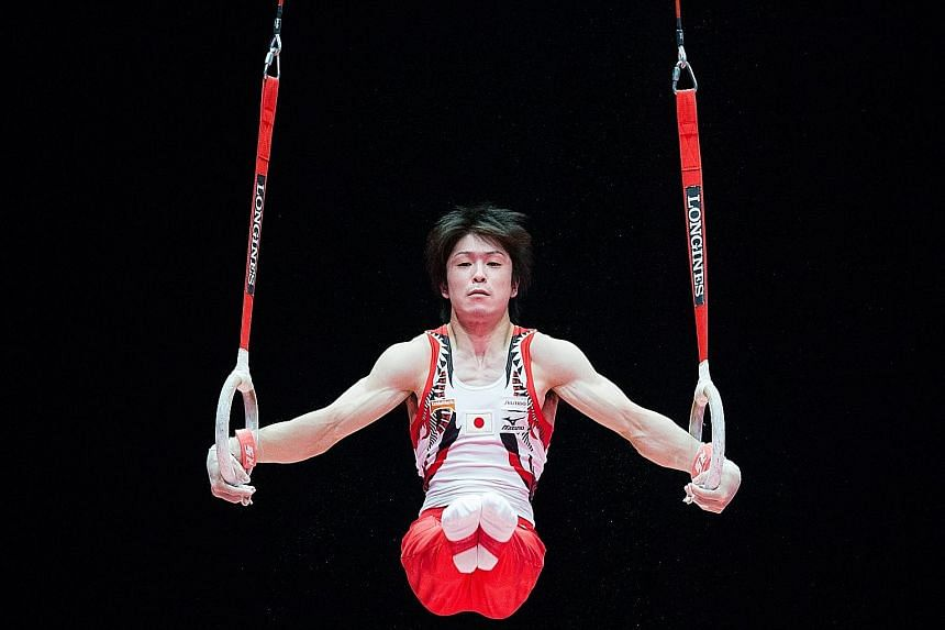 Japan's Kohei Uchimura on the rings at the World Gymnastics Championships in Glasgow yesterday. He fell during his routine on the horizontal bar, but his score was still sufficient to seal Japan's first team gold in 37 years.