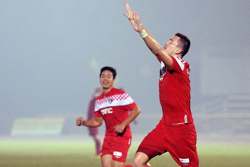 Robert Pericic (right) celebrating after scoring for Balestier Khalsa in a hazy S-League match against Courts Young Lions at Toa Payoh Stadium on Oct 19.
