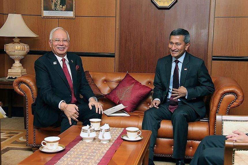 Dr Vivian Balakrishnan (at right) calling on Malaysian Prime Minister Najib Razak at Parliament House yesterday. Dr Balakrishnan is in Malaysia for two days from yesterday on an introductory visit as Foreign Minister.
