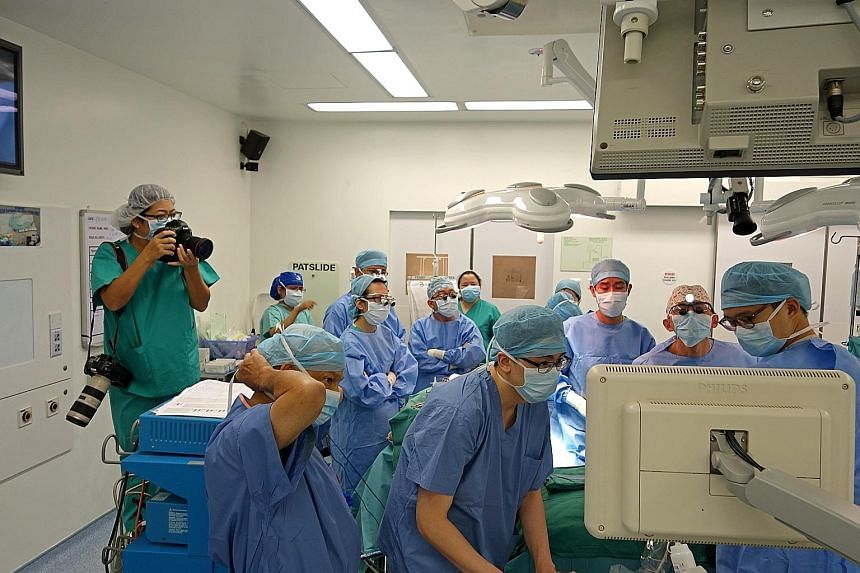 The transplant team looking at an ultrasound after the liver was implanted to ensure that all the vessels were working. Photojournalist Wang Hui Fen (far left) was in the operating theatre for the 12-hour transplant operation on Aug 1. Jeremy looking