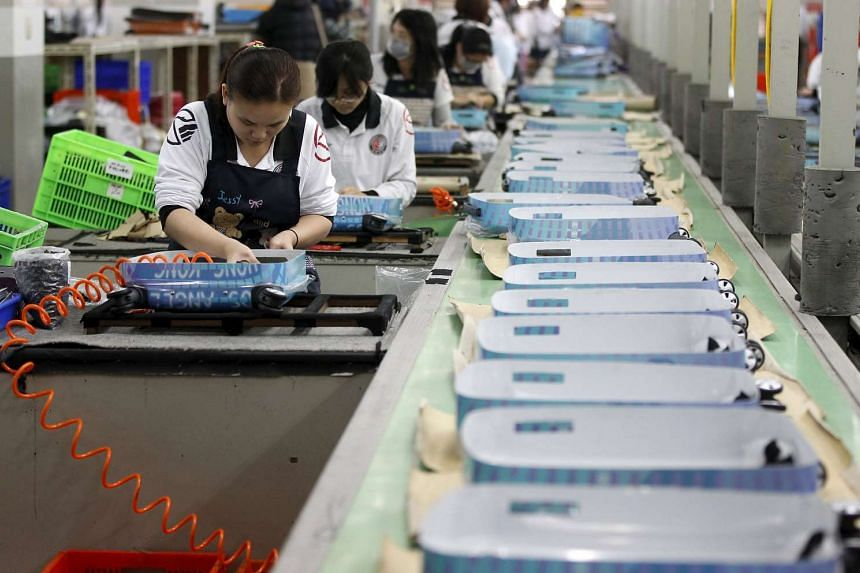 Employees working on a factory production line in Tainan in 2013.