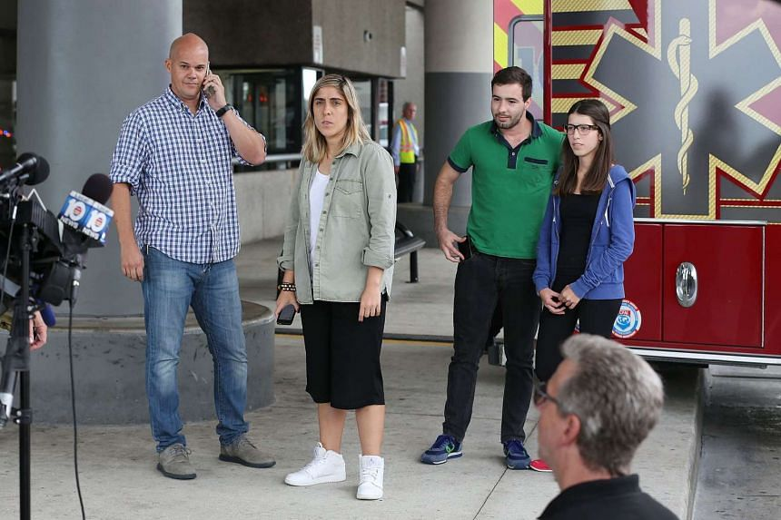(From left) Andres Gallego, Camilia Diaz, Davis Margo and Daniela Margo, who were on the Venezuela-bound plane that caught fire, waiting to talk to the media at the Fort Lauderdale-Hollywood International Airport on Oct 29, 2015.
