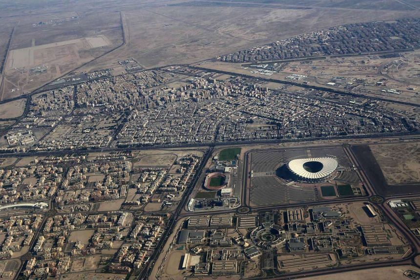 An aerial view taken from a plane shows a stadium and its surrounding areas in south of Kuwait City.