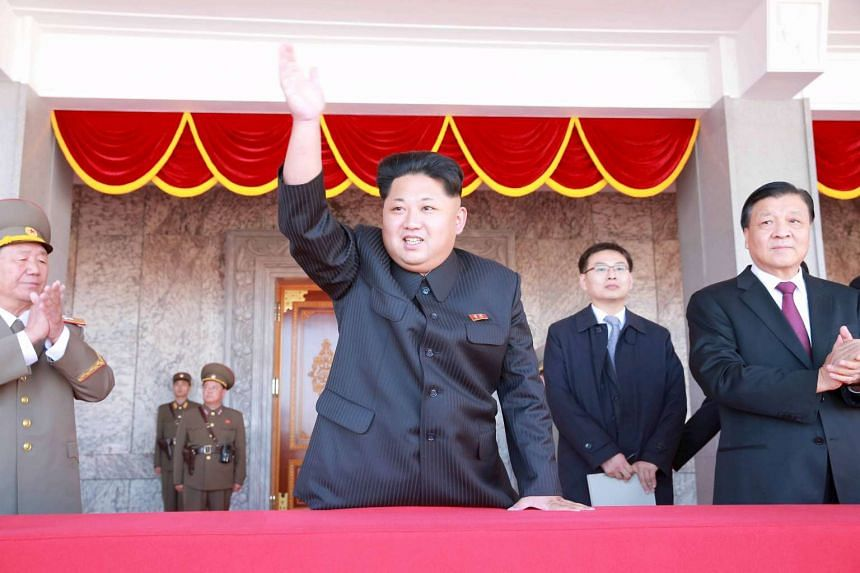 North Korean leader Kim Jong Un waving during a celebration of the ruling Workers' Party's 70th anniversary, in this undated photo released by the Korean Central News Agency on Oct 12, 2015.