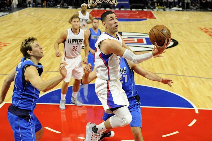Los Angeles Clippers guard Austin Rivers (Centre), was fined US$25,000 (S$35,000) by the NBA on Thursday for throwing a seat cushion that hit a fan in the face.