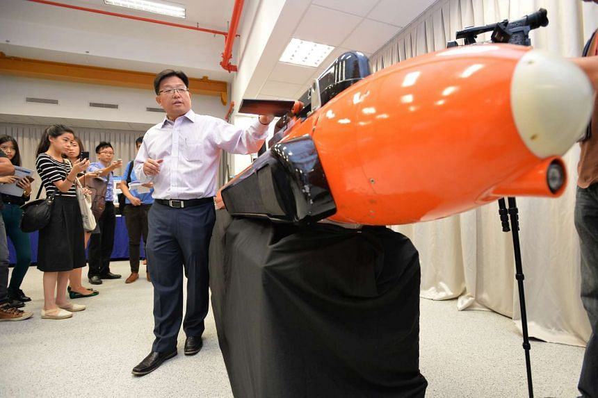 Mr Goh Ing Nam, 45, Programme Director, Sensors Division of DSO National Laboratories, explaining the compact Autonomous Underwater Vechicle.