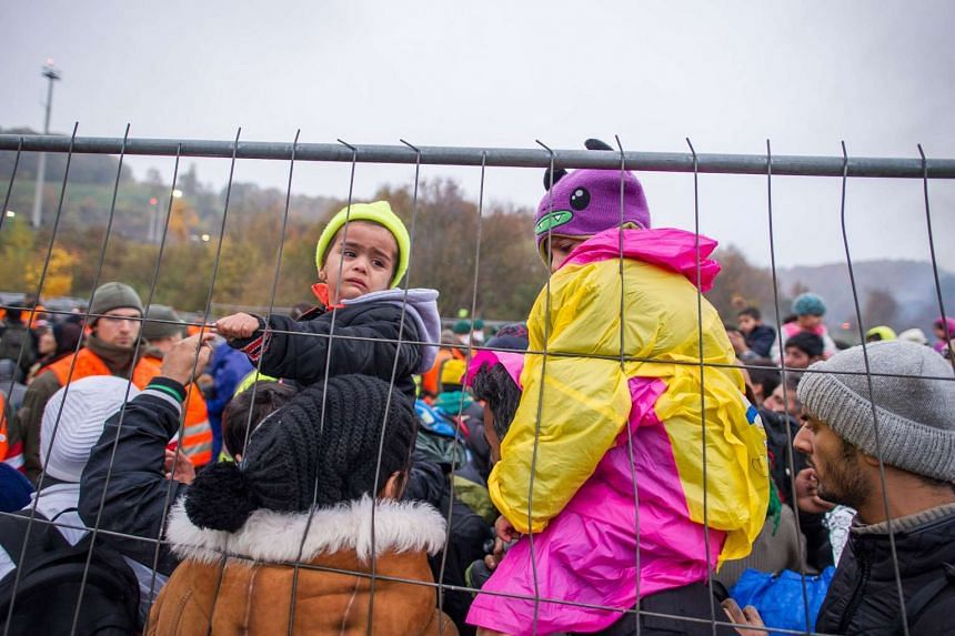 Migrants and refugees waiting to cross the Slovenian-Austrian border in Sentilj, Slovenia, on Oct 29, 2015.