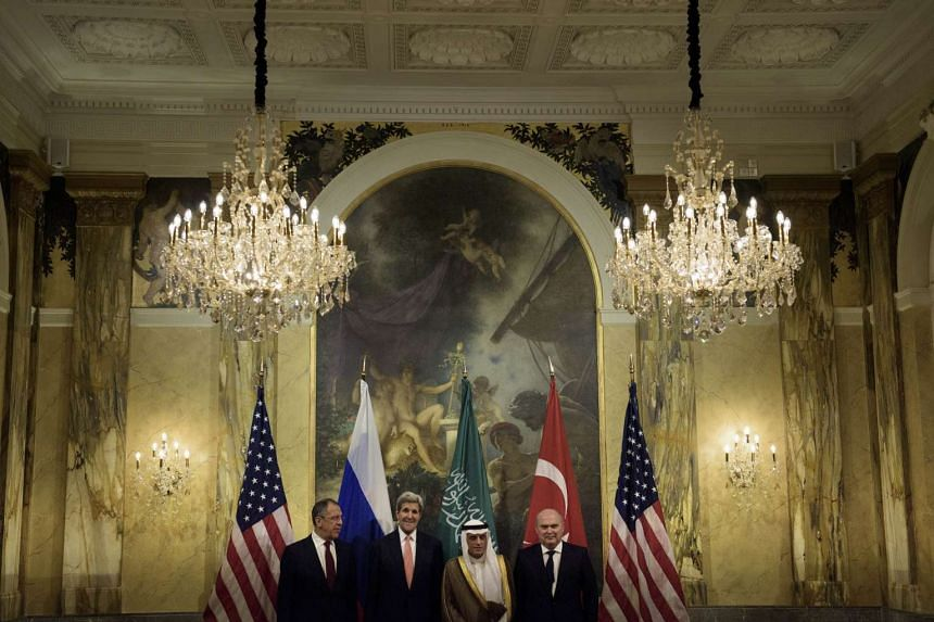 (From left) Russian Foreign Minister Sergei Lavrov, US Secretary of State John Kerry, Saudi Foreign Minister Adel al-Jubeir and Turkish Foreign Minister Feridun Sinirlioglu stand together before a meeting at the Hotel Imperial in Vienna on Oct 29, 20