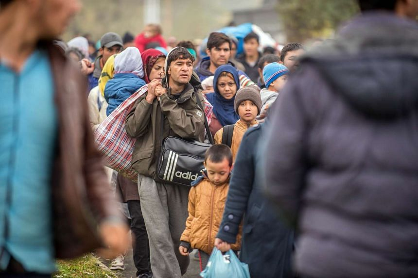 Refugees and migrants crossing the Slovenian-Austrian border on Oct 29, 2015.