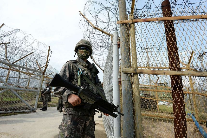 South Korean soldiers keeping watch near the scene where planted landmines exploded on Aug 4, 2015, in the Demilitarized zone dividing the two Koreas in Paju.