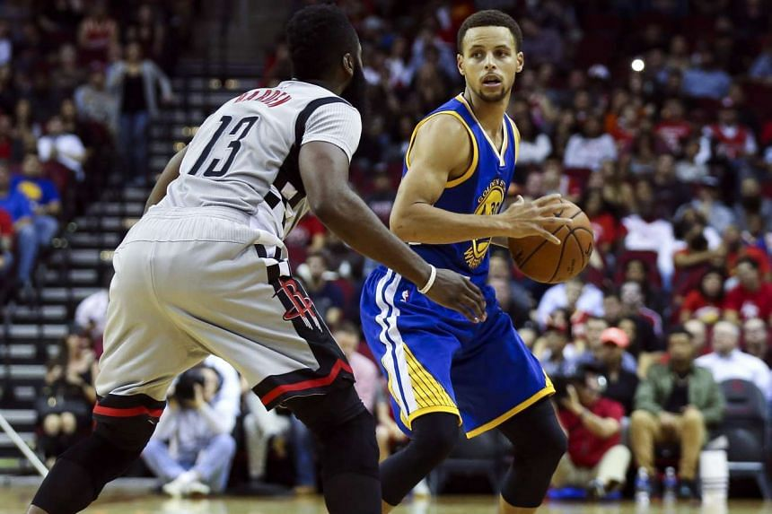 Warriors guard Stephen Curry (30) and Houston Rockets guard James Harden (13) during their match.