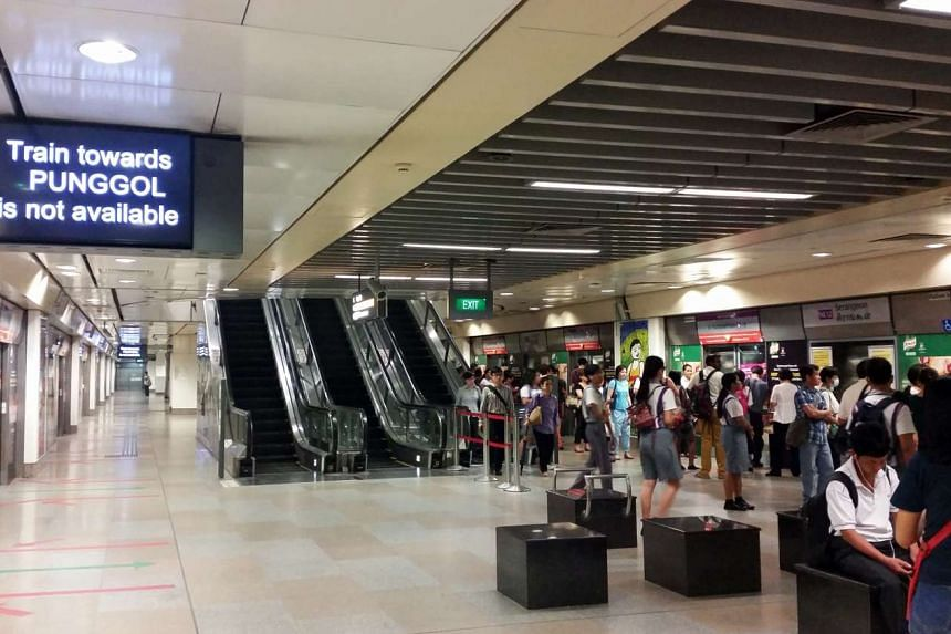 Commuters at Serangoon MRT station during a service disruption on Oct 26, 2015.