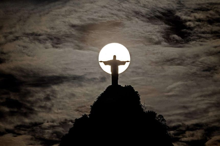 A sunset seen behind Christ the Redeemer and Corcovado hill in Rio de Janeiro on Oct 27, 2015.