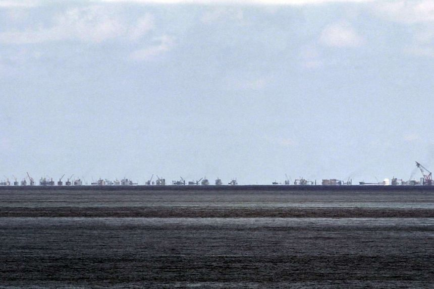 The alleged land reclamation by China at Subi reef is seen from Pagasa island in the Spratlys on May 11, 2015.