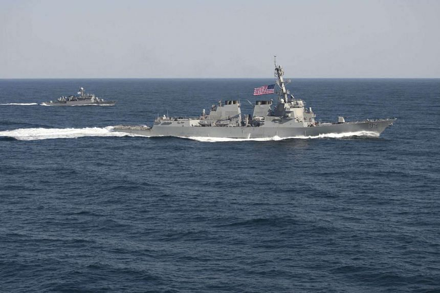 The USS Lassen (right) during an exercise in the Korean Peninsula on March 12, 2015.