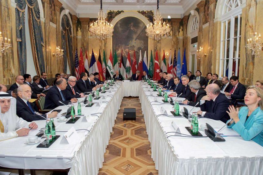 A handout photograph by the US Department of State showing US Secretary of State John Kerry sitting with his fellow Foreign Ministers at the Hotel Imperial in Vienna, Austria, on Oct 30, 2015, prior to a group discussion about ways to stop the fighti