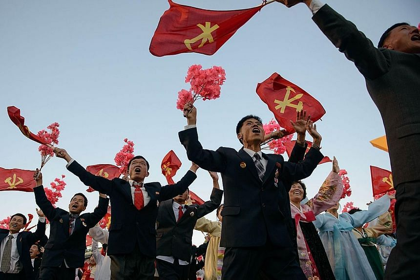 A mass parade in Pyongyang on Oct 10 to mark the 70th anniversary of the Workers' Party. The party emblem, which bears the communist hammer and sickle, also incorporates a calligraphy brush to symbolise the working intellectual.
