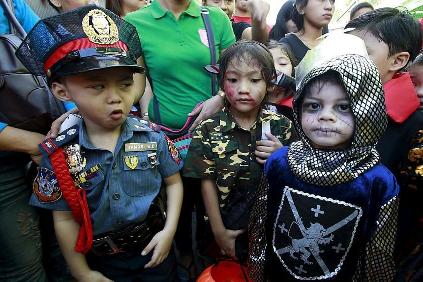 It was a clash between knight and military might for these pupils from Brainshire School in the Philippines. They donned costumes that pay tribute to battlefield heroes as they participated in a Halloween parade in Paranaque city, metro Manila, yeste