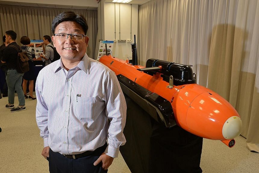 Mr Goh Ing Nam, DSO's Sensors Division programme director, with the M400 Autonomous Underwater Vehicle.