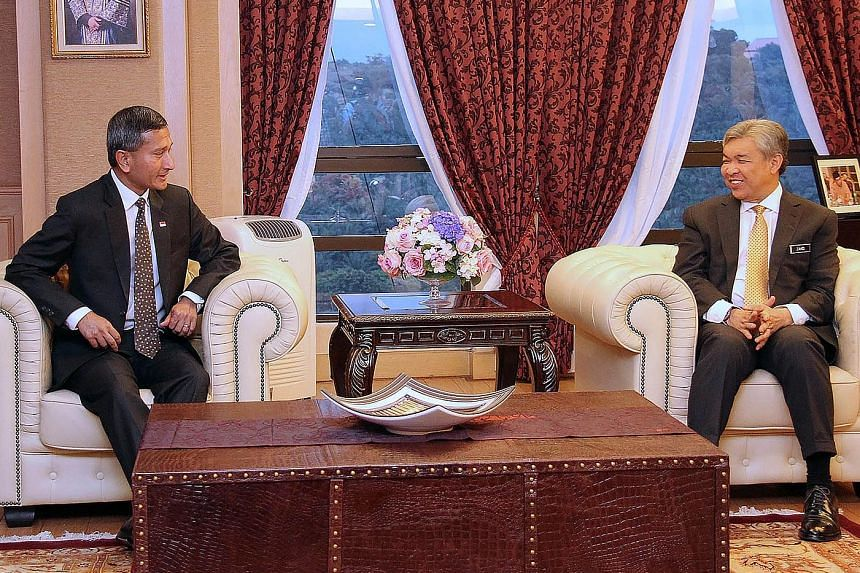 Singapore Minister for Foreign Affairs Vivian Balakrishnan (left) yesterday called on Malaysian Deputy Prime Minister Ahmad Zahid Hamidi in Kuala Lumpur during a two-day introductory visit to Malaysia, and reaffirmed the excellent ties between the tw