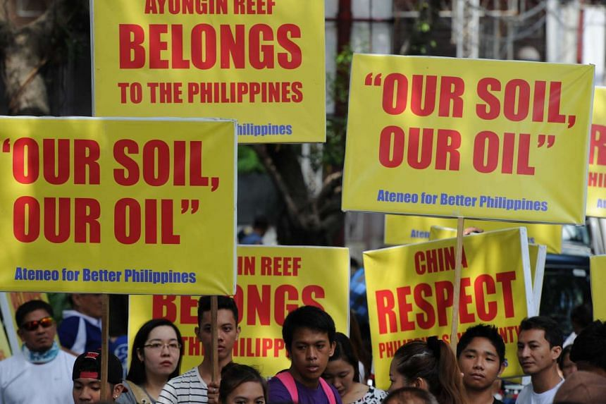 Protesters displaying placards during a rally in front of the Chinese consulate in Manila on Aug 31, 2015.