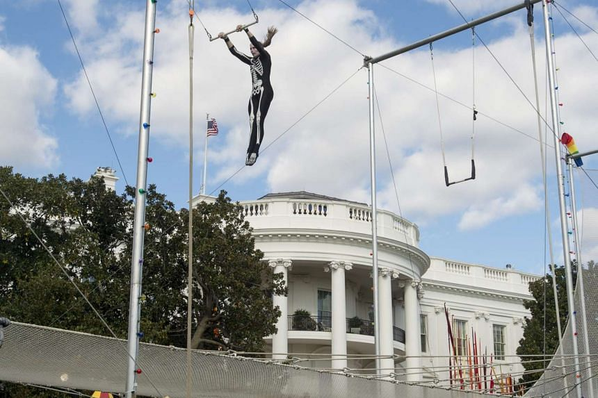 Acrobats warming up before a Halloween event hosted by US President Barack Obama and First Lady Michelle Obama on the South Lawn of the White House on Oct 30, 2015.