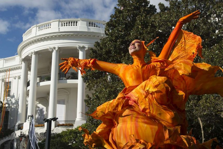 Performers warming up for a Halloween event hosted by US President Barack Obama and First Lady Michelle Obama on the South Lawn of the White House on Oct 30, 2015.