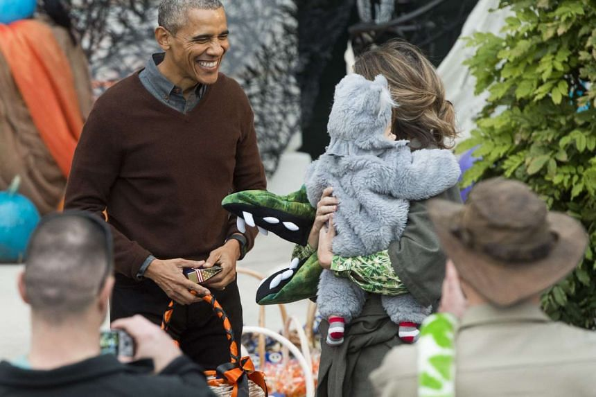 US President Barack Obama handing out treats to children for Halloween on the South Lawn of the White House on Oct 30, 2015.