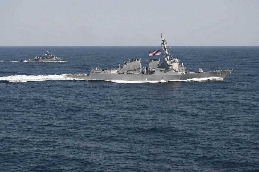 USS Lassen (DDG 82) (right) transits in formation with ROKS Sokcho (PCC 778) during exercise Foal Eagle 2015, in waters east of the Korean Peninsula, in this Mar 12, 2015 file handout photo provided by the US Navy.