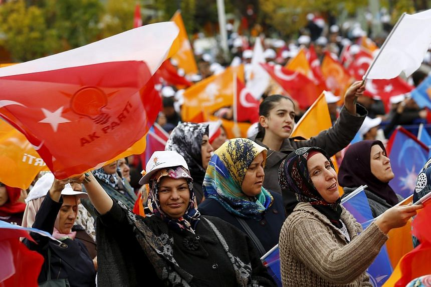 Supporters of the ruling AK Party wave national and party flags during an election rally in Ankara, Turkey, on Oct 31, 2015.