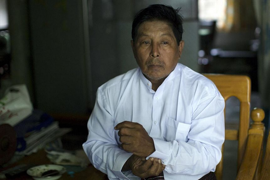 Muslim candidate Khin Maung Thein pauses during an interview in Mandalay on Oct 5, 2015.