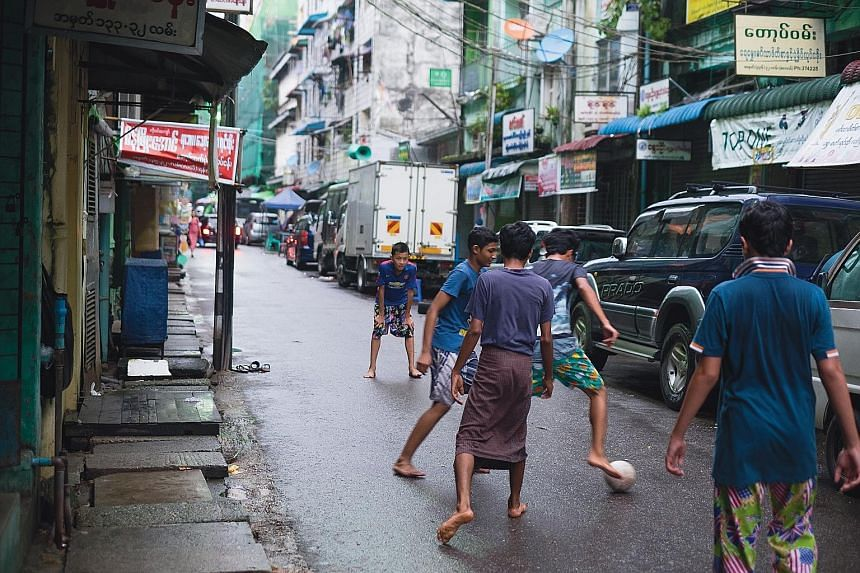 Myanmar has a shortage of proper sports facilities and infrastructure, so kickabouts played on street alleys, underneath overpasses and on the roads are a common sight in the country.