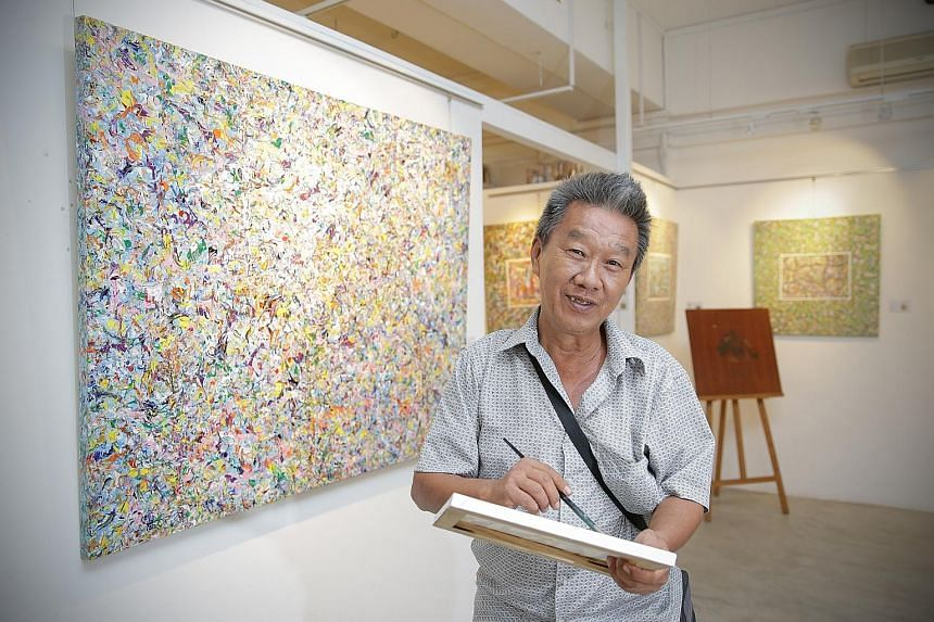 Mr Tan Chong Bin at his first solo exhibition, Voice Of A Karung Guni Man, at Artcommune Gallery in Bras Basah. Thirty pieces of his works are on display and more than 10 pieces, ranging in price from $400 to $1,700, have been sold.