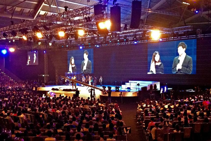 Pastor Kong Hee and his wife, Ms Ho Yeow Sun, on stage during a City Harvest service in 2012. The 140-day trial of the City Harvest Church leaders, which took place over two years, was a delicate balancing act for a secular state.