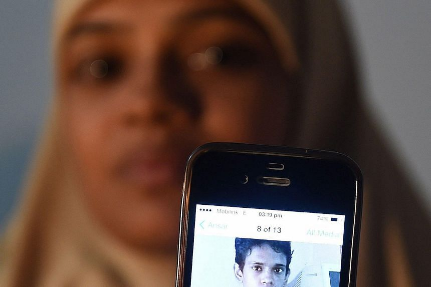 Ms Razia Begum with a picture of her son Mohammad Ramazan, who has been stuck in India since 2008.