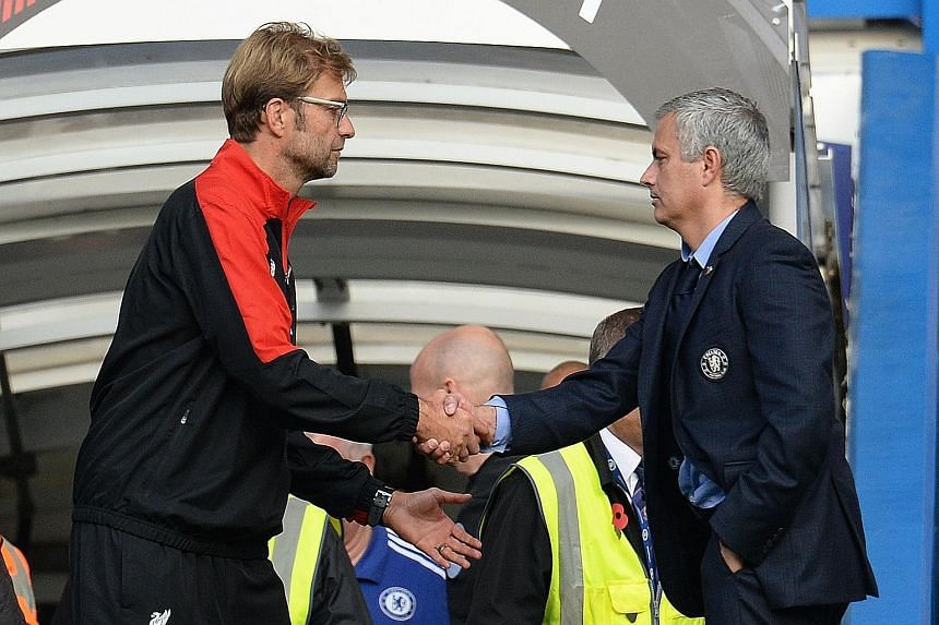 Liverpool manager Juergen Klopp, shaking hands with Chelsea manager Jose Mourinho at the end of the match, gets his first league victory after taking over.