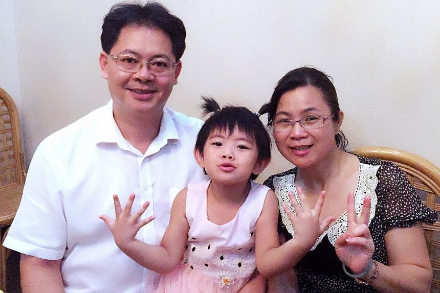 HOPING FOR ANOTHER CHILD: Ms Deng Xiaen with her husband Zhou Jie and their four-year-old daughter Yutong. The couple have decided to have a second child after initially grappling with a decision. FILLED WITH REMORSE: Ms Jin Hongyan with her husband