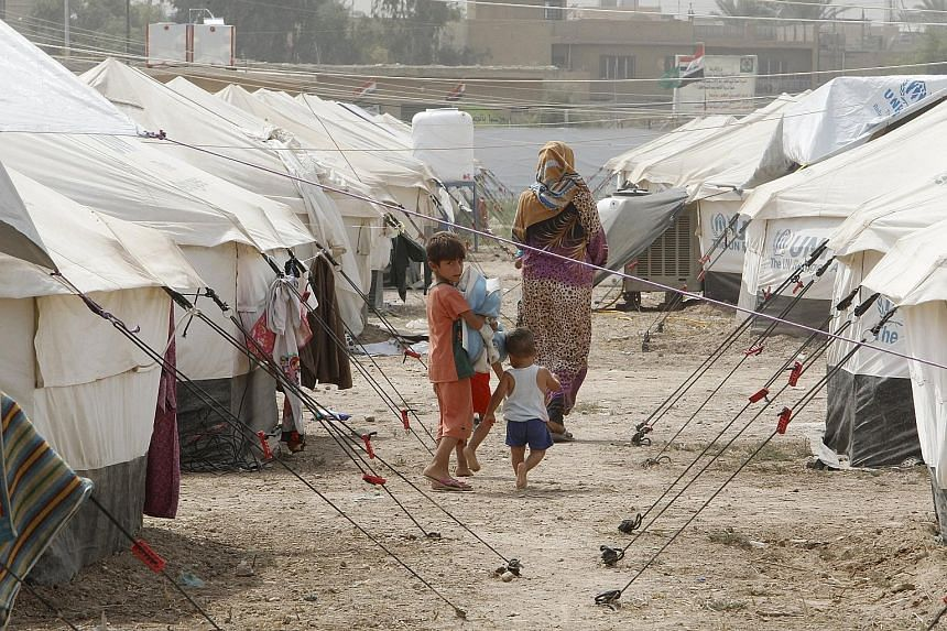 The Islamic State in Iraq and Syria (ISIS) has wreaked havoc on people such as these Iraqi Sunnis who had to flee the militants in Ramadi and Fallujah to a refugee camp in Baghdad. It has been able to put forward an alternate history that twists Isla