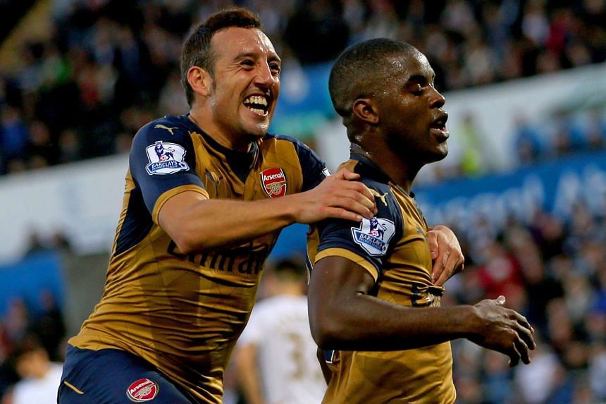 Arsenal striker Joel Campbell (right) celebrates with midfielder Santi Cazorla after scoring their third goal.