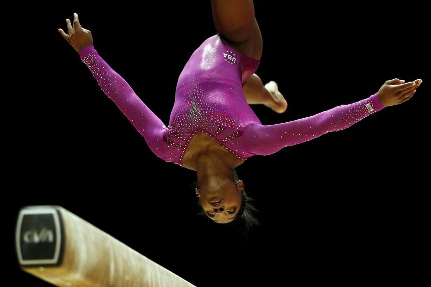 Simone Biles performs during her beam routine in the women's apparatus final.