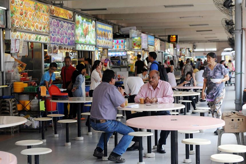People eating at Marine Parade Food Centre on May 27, 2015.